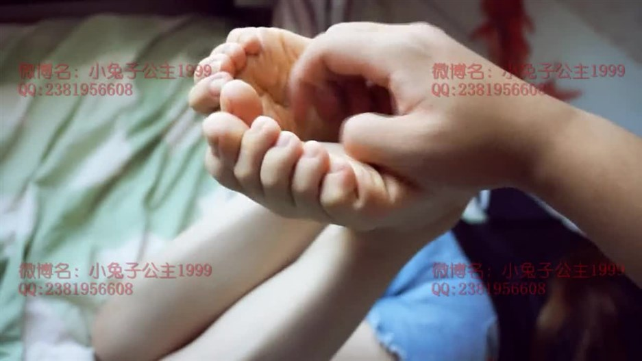 Tickle chinese girl's feet